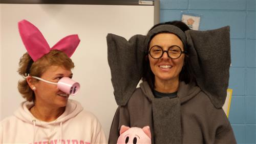 Mrs. Newell and Mrs. Donahue dressed up like Piggie and Gerald