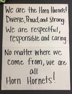 Sign promoting respectful, responsible, caring behavior