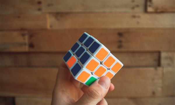 Hand holding a Rubik's Cube
