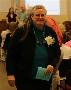 Dr. Shea recognized by DPO with corsage and certificate