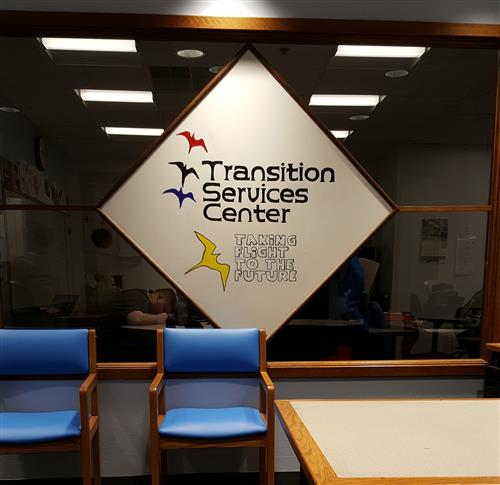 Picture of the Transition Services Window with their logo of 4 birds taking flight